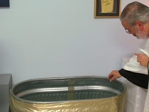 Blessing the baptismal water.