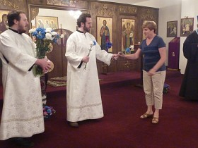 Parishioners receive blessed flowers