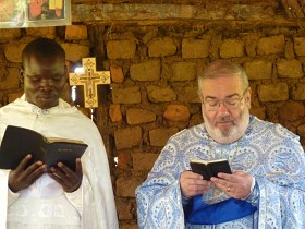Fr. George and Fr. Joseph read the gospel<br> in Ugandan and in English