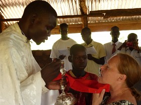 Dr. Sue receives communion<br>.