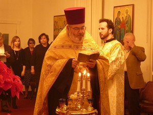 Fr. Joseph prays at Litya
