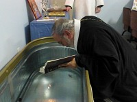 Fr. Joseph blesses<br> the baptismal water.