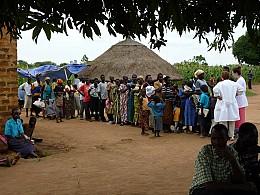 Nurse-parishioner Karleen Kuntz helps treat<br>patients in Uganda.