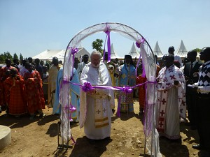 Fr. Joseph cuts the ribbon to open the health Center